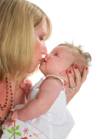 Mom Hold and Kiss Baby Girl on White Background Stock Photo - 5782370