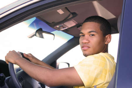 Young Smiling African American Male Driving a Car photo
