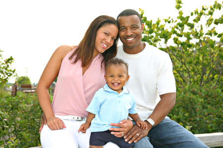 happy african: Happy African American Family Outdoor In Summer Sunny Day Stock Photo