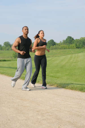 Young Couple Jogging Outdoor at Park under Summer Sky Stock Photo - 5782647