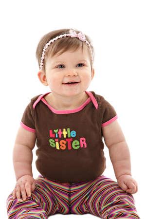One Year Old Baby Girl Sitting on Floor Smiling Isolated on White Bakcground Stock Photo - 7078319