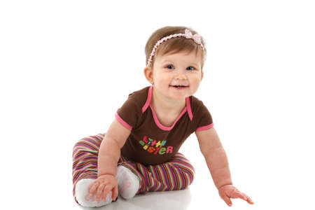 One Year Old Baby Girl Sitting on Floor Smiling Isolated on White Background Stock Photo - 7078246