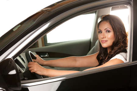 felicidade: Joyful Asian Female Driver Look Out of Car Window Imagens
