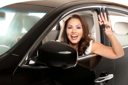 Joyful Asian Female Driver Look Out of Car Window Holding Keys photo