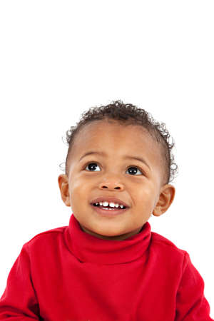 Looking Up Smiling Adorable African American Boy on Isolated White Background Stock Photo - 10531735