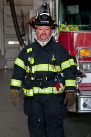 fire fighter: FireFighter standing in front fire truck portrait