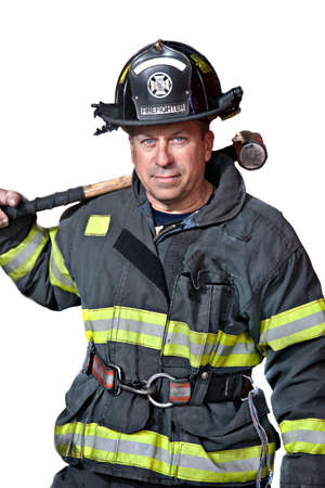Serious looking confident firefighter standing portrait photo