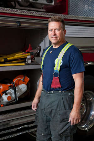 FireFighter standing in front fire truck portrait photo