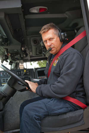 Fire Truck Driver with Headphone on photo