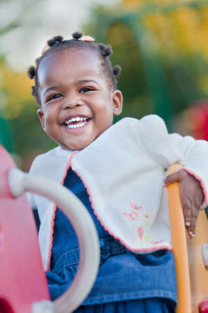 3-year old African American Girl Playing in the Playground photo