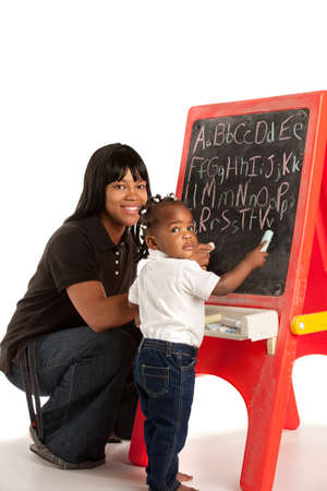3 year old: 3 Year Old African American Girl and Mom Standing in font of Blackboard Stock Photo
