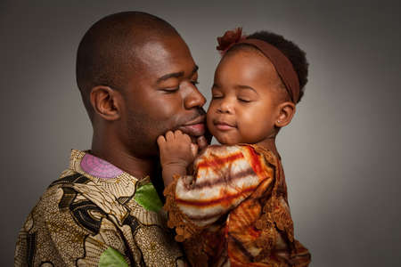 Happy African American Father Holding Baby Girl Portrait Isolated on Grey Background Stock Photo - 10531910