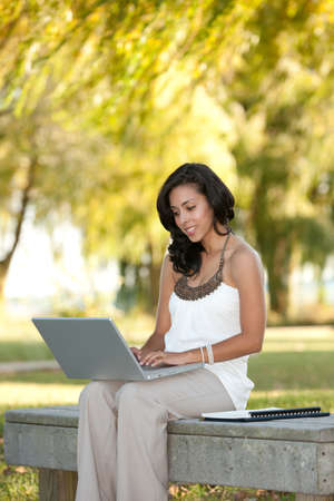 internet education: Young Hispanic Female Businesswoman Working Outdoor Smiling