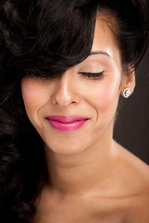 Beautiful hispanic woman close-up portrait smiling photo