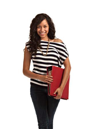 notebook: Happy Hispanic Teenager Casual Dressed Holding Notebook  on Isolated White Background Stock Photo