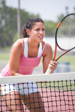 tennis serve: Youn female tennis player ourdoor playing Stock Photo