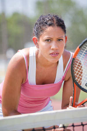 serve: Youn female tennis player ourdoor playing Stock Photo