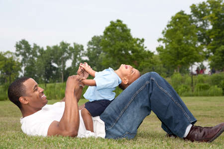 Father and Son Playing Outdoor Park in Summer photo