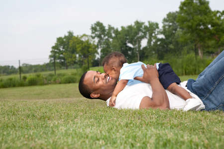 fatherhood: Father and Son Playing Outdoor Park in Summer Stock Photo