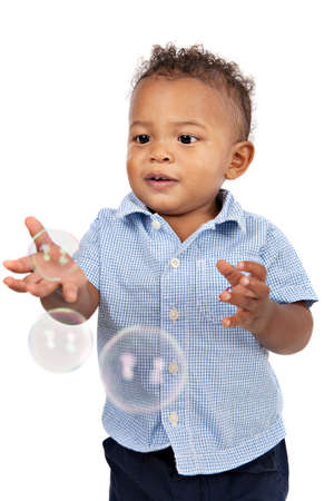 Adorable One Year Old African American Boy Playing Bubbles Isolated photo