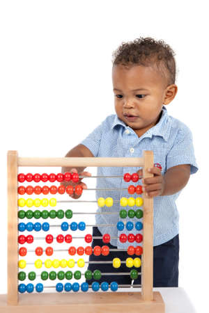 early childhood: Adorable One Year Old African American Boy Playing Wooden Abacus Isolated
