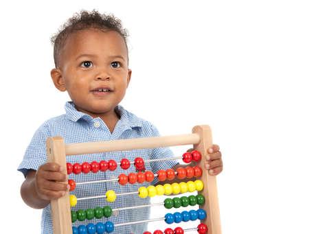 black block: Adorable ni�o afroamericano un a�o de edad tocando madera Abacus aislado