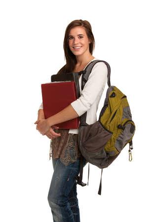 バックパック: カジュアルな服装の孤立した背景に笑みを浮かべて高校生