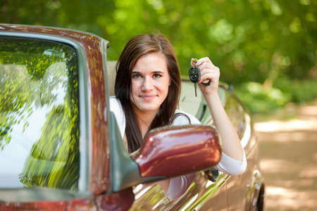 Joyful Teenager Female Driver Arm Out in Convertible photo