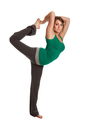 Pretty Female Teenager Practicing Yoga on Isolated White background photo