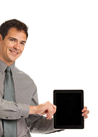 blank tablet: Laughing Young Businessman Holding a Touch Pad Tablet PC on Isolated White Background Stock Photo