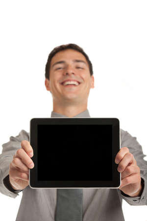 Laughing Young Businessman Holding a Touch Pad Tablet PC on Isolated White Background Stock Photo - 10686165