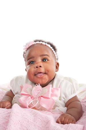 happy big smiling 6-month old African American baby girl portrait photo