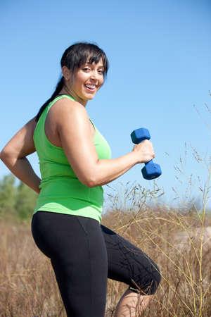Plus Size Female Exercise Outdoor Happy Smile Under Sunny Blue Sky photo