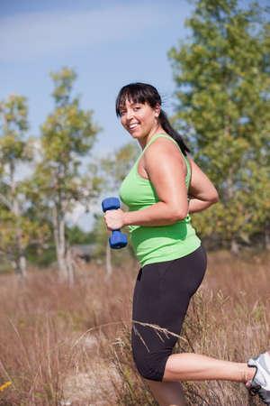 plus size: Plus Size Female Exercise Outdoor Happy Smile Under Sunny Blue Sky Stock Photo