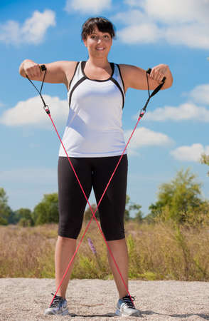 Plus Size Female Exercise Outdoor on Fitness Strap in water front photo