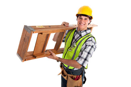 Young Happy Carpenter Carrying Ladders on Isolated Background photo