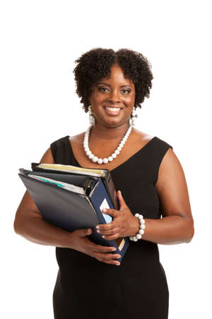 Cheerful Plus Size Businesswoman Holding Binders Standing Isolated on White Background photo