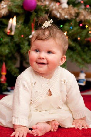 Cute Infant Baby in front of Christmas Tree Wearing Santa Hat Stock Photo - 10764320