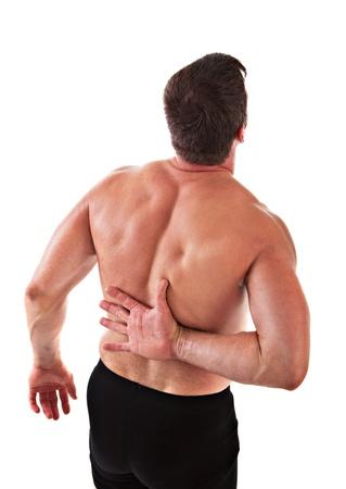 dolor muscular: Dolorosos de mediana edad el hombre Holding Back en el fondo aislado Foto de archivo