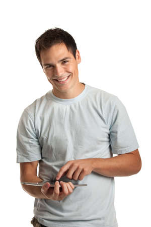 Laughing Casual Young Man Holding a Touch Pad Tablet PC on Isolated White Background photo