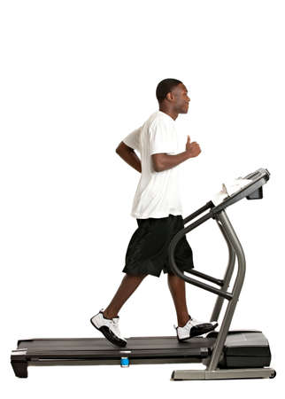 Healthy Young African American Running in Treadmill Isolated on White Background photo