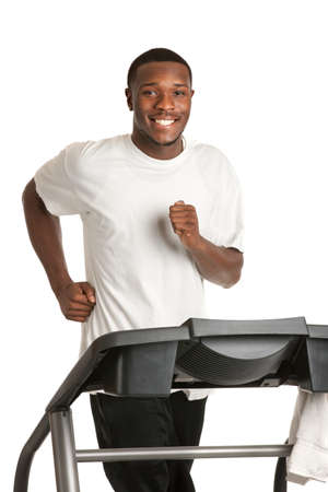 Healthy Young African American Running in Treadmill Isolated on White Background Stock Photo