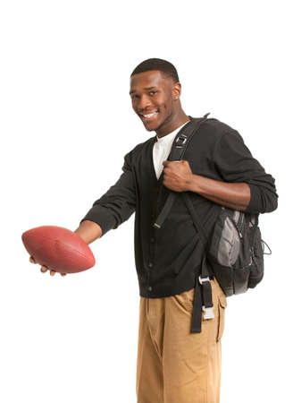 Casual Dressed Happy College Black Student Holding Football Isolated on White Background Stock Photo - 10918861