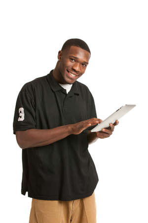 Happy African American College Student Working on Touch Screen Tablet PC photo