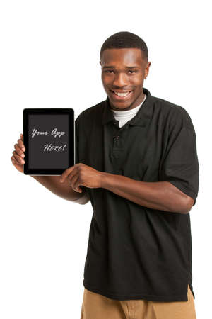 mobile app: Laughing Young African American Male Holding a Touch Pad Tablet PC on Isolated White Background