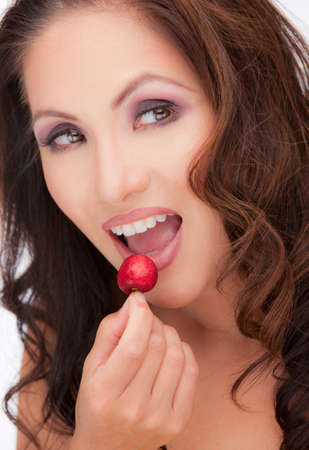 Asian Female Closeup with Red Cherry Temptation Expression photo