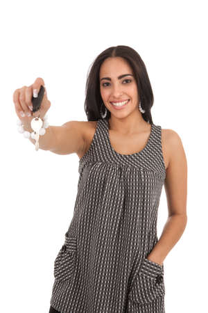 Young Happy Hispanic Female Hand over Car Key, Focus on Key, Close-up photo