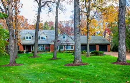 Classical North American Residential House in Wooded Area in Fall Season photo