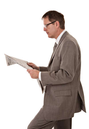 Serious Looking Businessman Reading Newspaper on Isolated White Background photo