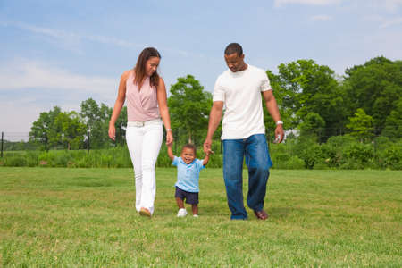 Happy smiling Boy Playing Outdoor with Parents In Summer Sunny Day photo